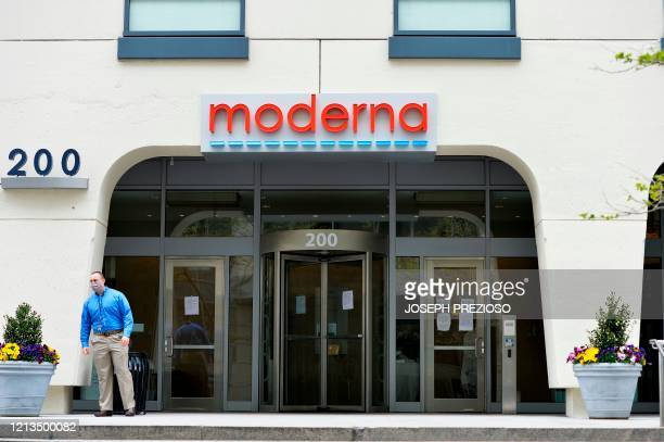 A man stands outside Moderna headquarters in Cambridge Massachusetts on May 18 2020 US biotech firm Moderna reported promising early results from the...