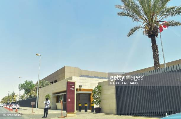 A man stands outside the Canadian Embassy in the Saudi capital Riyadh on August 7 one day after Saudi Arabia said it was expelling the Canadian...