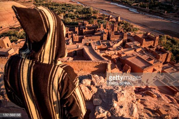 A man stands overlooking the Kasbah of AitBenHaddou where scenes depicting the fictional city of Yunkai from the hit HBO television series Game of...