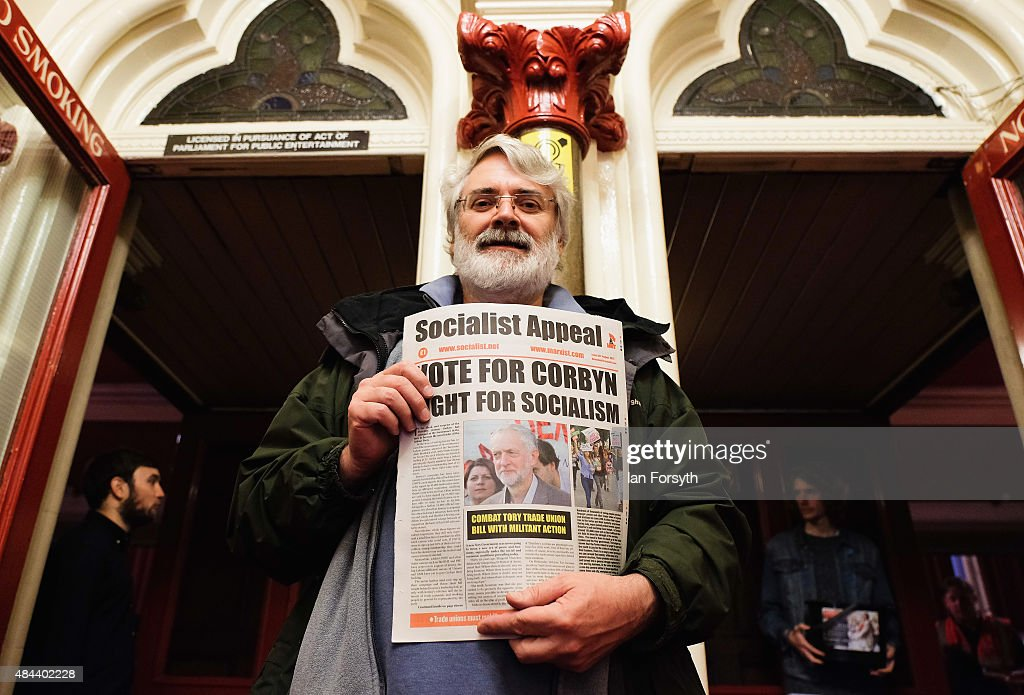 A man stands selling newspapers ahead of a speech by British Labour Party leadership contender Jeremy Corbyn who was taking part in a nationwide leadership campaign at the Town Hall on August 18, 2015 in Middlesbrough, England. The Labour party leadership election was triggered by the resignation earlier in the year of Ed Miliband following the party's defeat at the general election. Four candidates were successfully nominated to stand, Andy Burnham, Yvette Cooper, Jeremy Corbyn and Liz Kendall. The result of the campaign will be announced on Saturday 12 September 2015.