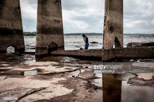 TOPSHOT A man stands the banks of the Congo River on January 18 2019 in Kinshasa