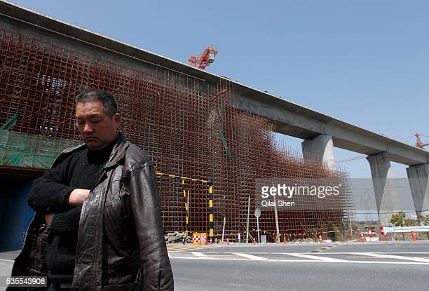 A man stands under an elevated base for the planned ShanghaiHangzhou highspeed rail near Shanghai China on 17 March 2010 In just a few years China...