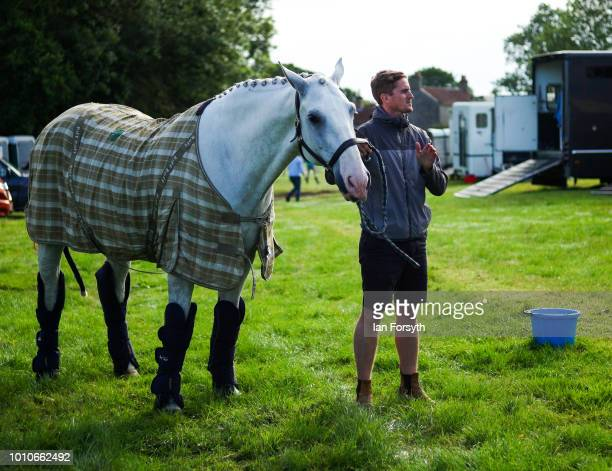 A man stands with his horse during 152nd the Ryedale Country Show on July 31 2018 in Kirbymoorside England Held in Welburn Park near Kirbymoorside in...