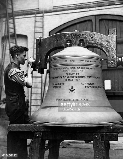 A man stands with the tenor bell from the Cathedral Church of St Martin Leicester which is being renamed the Coronation Bell of King George VI at...