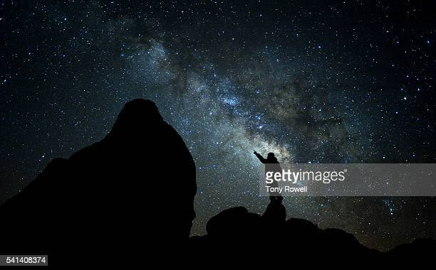 Man stargazing under the Milky Way in Alabama Hills, California, USA