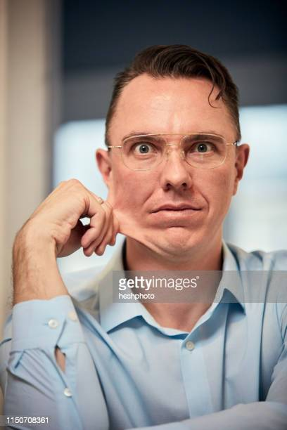 man staring and pinching face - heshphoto imagens e fotografias de stock