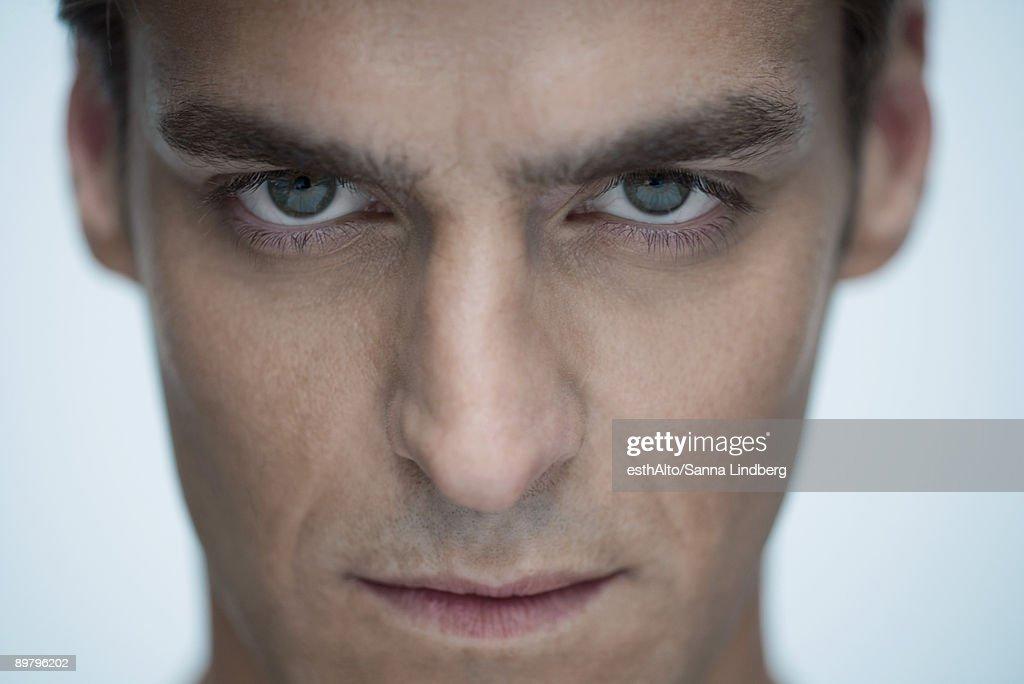 Man staring at camera, close-up : Stock Photo
