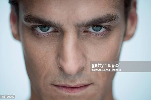 man staring at camera, close-up - staring stock photos and pictures