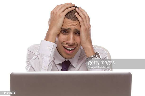 man staring at laptop with shocked and desperate expression - error message stock pictures, royalty-free photos & images