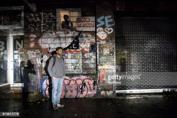 Man stay in spotlight during riots in St Pauli district during G 20 summit in Hamburg on July 8 2017 Authorities are braced for largescale and...