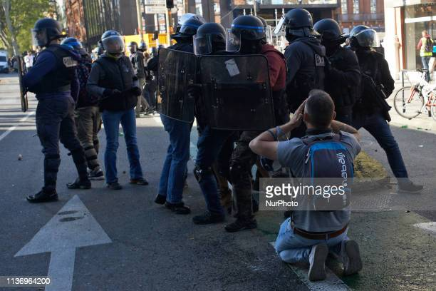 A man stays on his knees in front of riot police The 'Gilets jaunes' protest for the 22nd week in a Row For the Act 22 dubbet 'All in Toulouse' the...