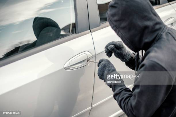 man stealing a car - looting stock pictures, royalty-free photos & images