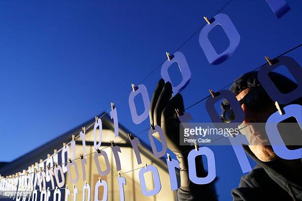 man stealing numbers from washing line - data privacy stock pictures, royalty-free photos & images