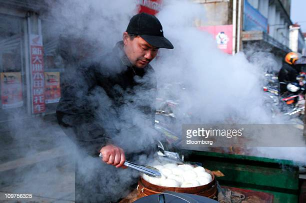A man steams dumplings at a market in Zhujiao Township Chuzhou Anhui Province China on Wednesday March 2 2011 As Chinese Premier Wen Jiabao this week...