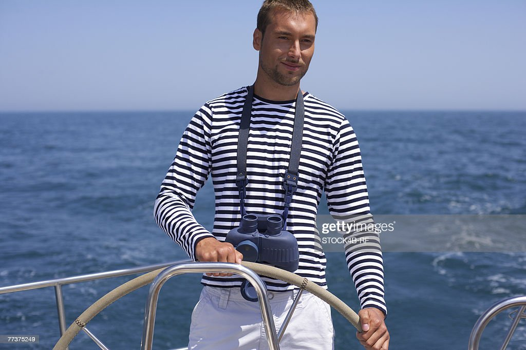 Man steering a Boat : Photo