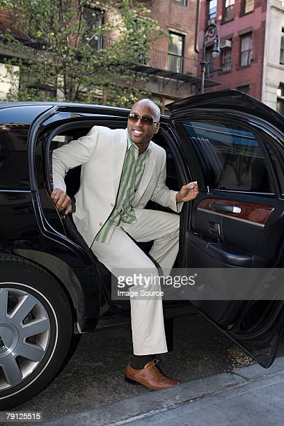 man stepping out of limousine - best sunglasses for bald men stock pictures, royalty-free photos & images