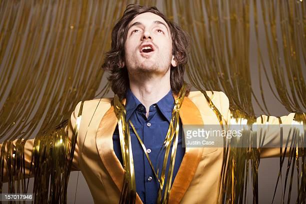 a man stepping through a golden curtain - singen stock-fotos und bilder