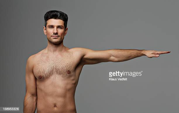 Man stetching arm out to the side