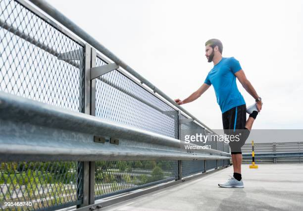 Man stetching on a parking level