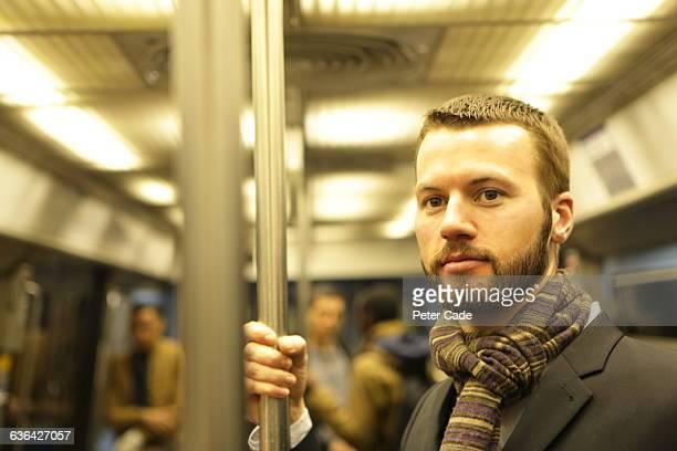 Man stood on underground train