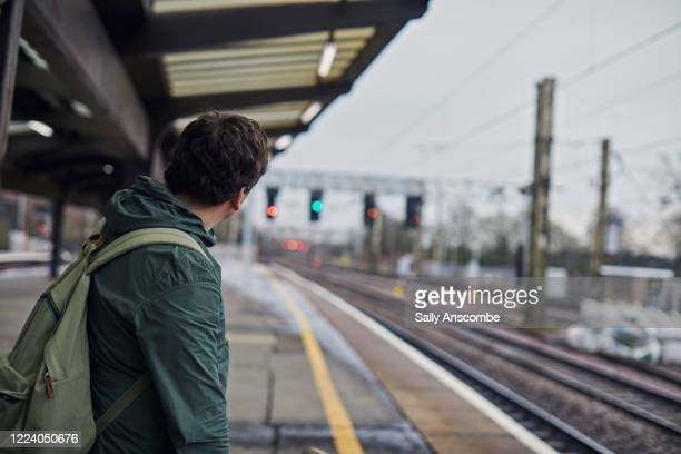 man stood waiting for the train - british people stock pictures, royalty-free photos & images