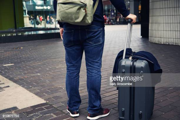 Man stood with suitcase