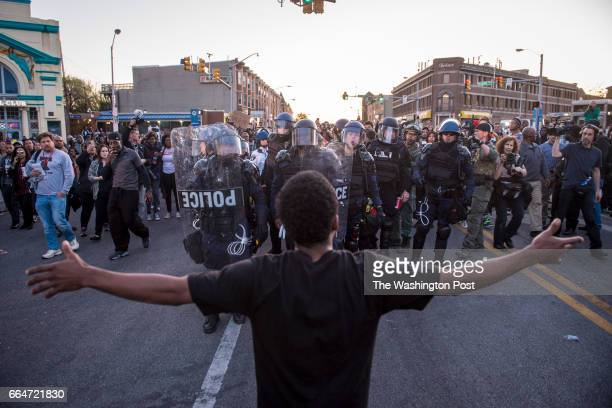 A man stops and yells at officers as they make their way through the crowd to help a person who needed medical attention near the intersection of...