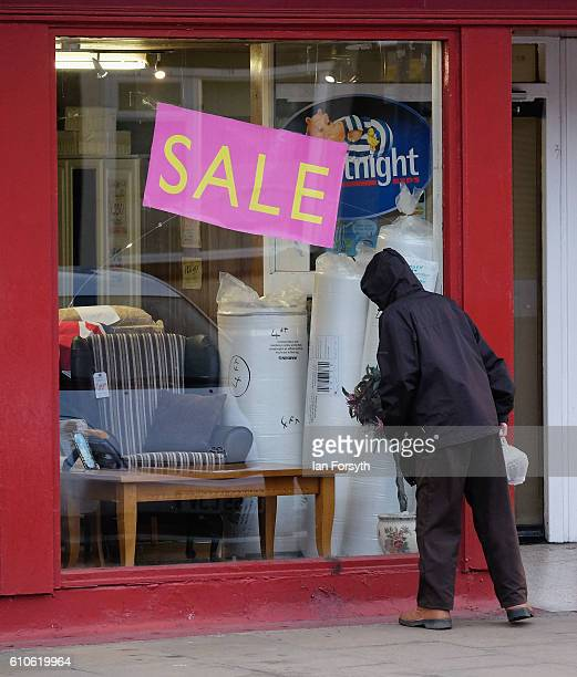 A man stops to look through a shop window in Redcar high street on September 27 2016 in Redcar United Kingdom One year on since the SSI steel making...