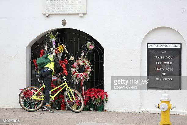 A man stops to observe the makeshift memorial in front of Mother Emanuel AME Church in downtown Charleston South Carolina on January 4 2017 Dylann...
