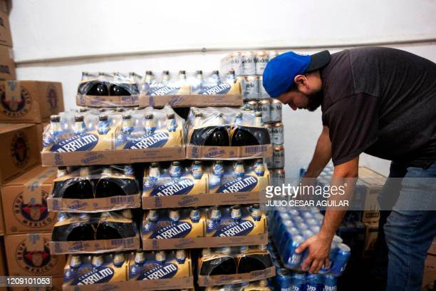 A man stores beer in a shop in Monterrey Nuevo Leon state on April 5 2020 Two Mexican brewers including the producers of Corona beer have said they...