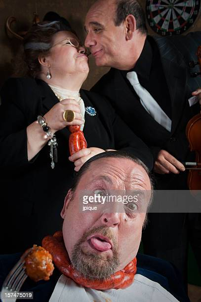 man strangled by his wife - couple tongue kissing stock photos and pictures
