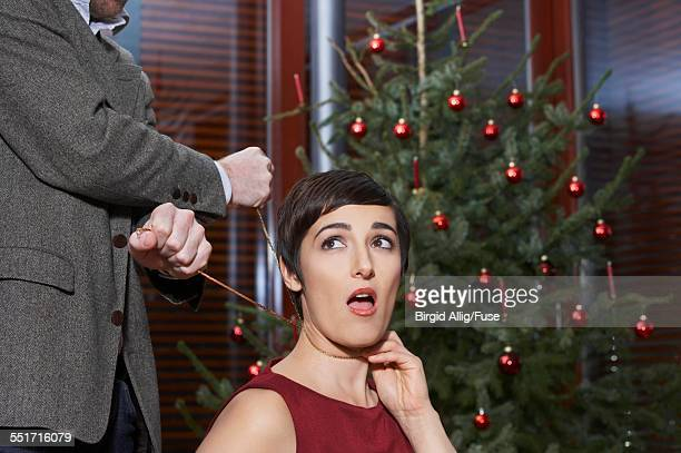man strangling woman on christmas - women being strangled stock photos and pictures