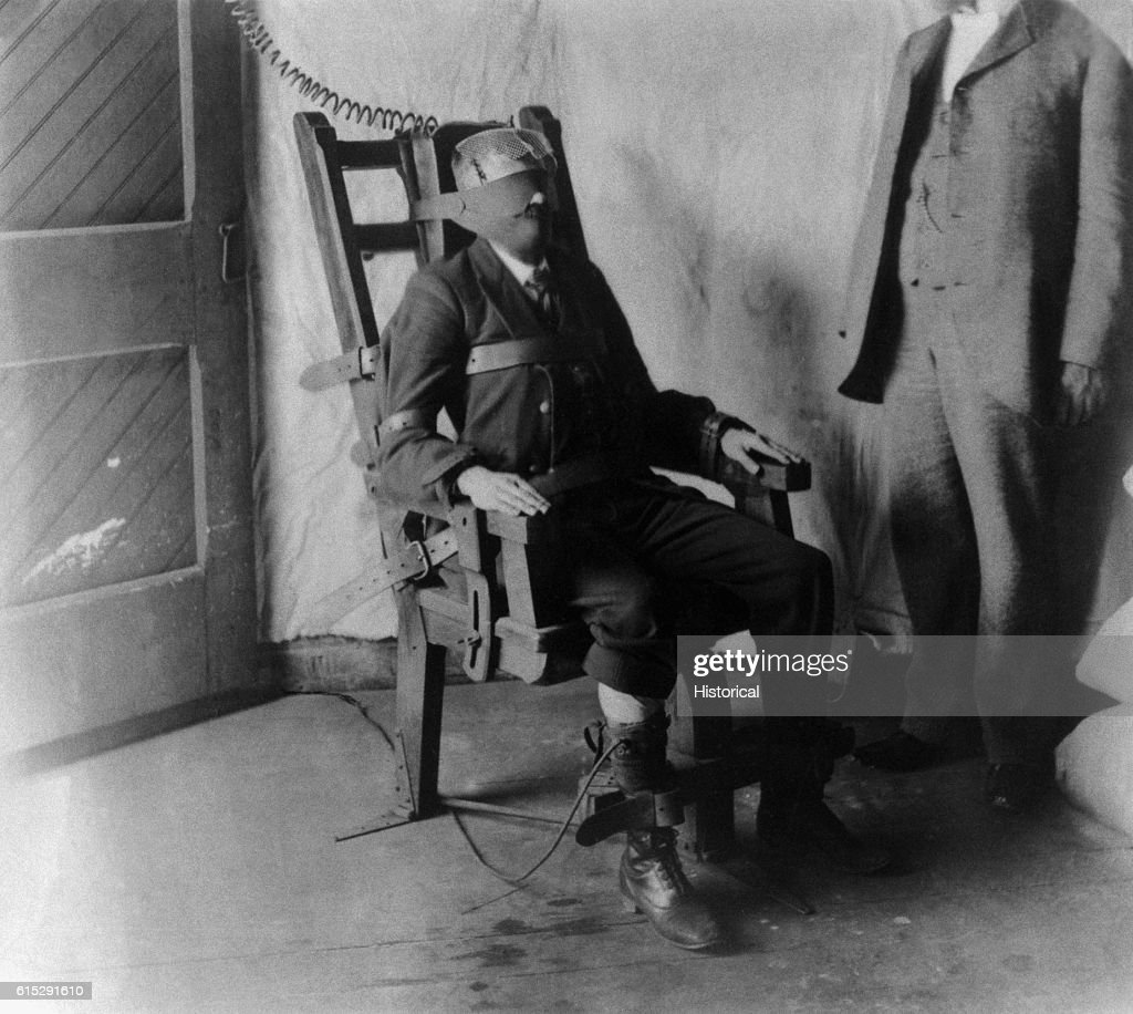 A Man Strapped Into An Electric Chair Awaits His Execution By  Electrocution. United States,