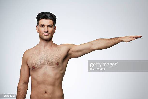 Man stretching arm out to the side
