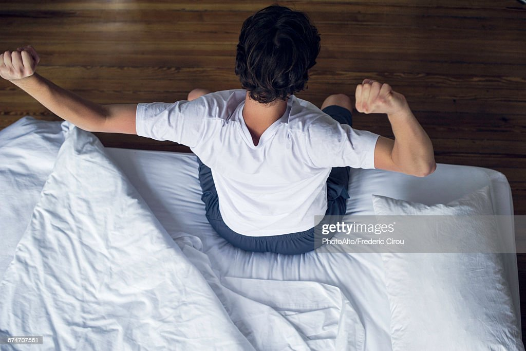 Man stretching as he wakes up : Stock-Foto