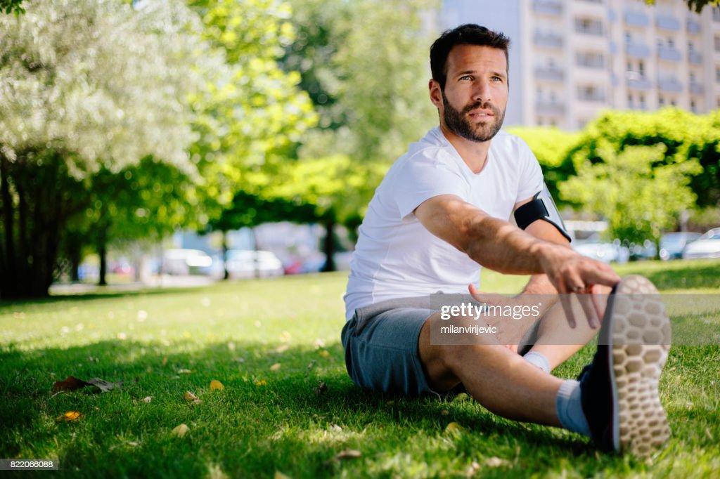Man stretching before morning training : Stock Photo