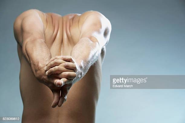Man stretching his arms and shoulders