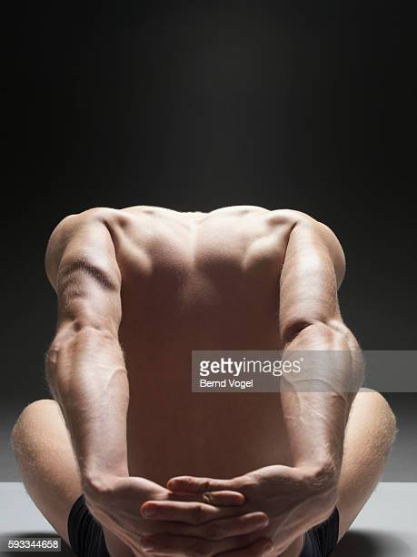 Man stretching his arms behind him