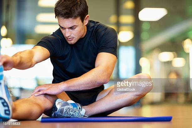 Man stretching his hamstring muscle
