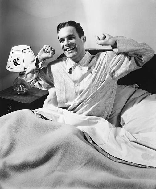 Man Stretching In Bed, (B&W), Wall Art