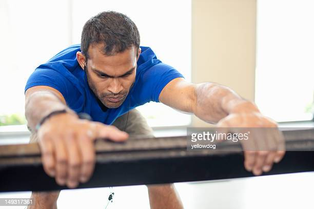 man stretching in gym - barre stock photos and pictures