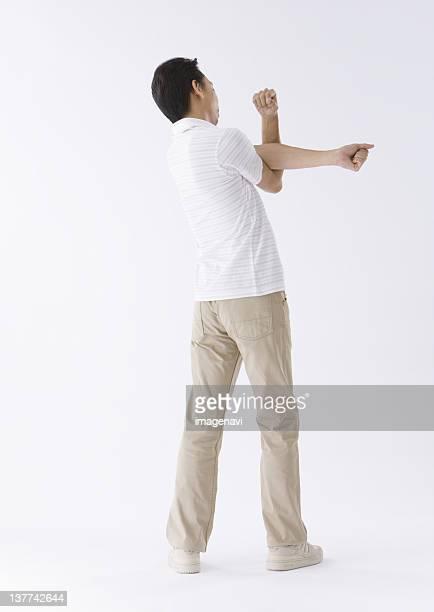 man stretching - ポロシャツ ストックフォトと画像