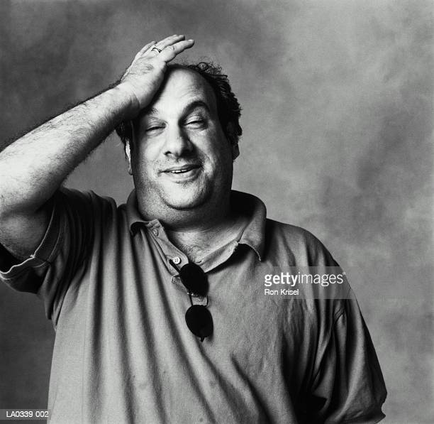 man striking head, portrait (b&w) - slapping stock pictures, royalty-free photos & images