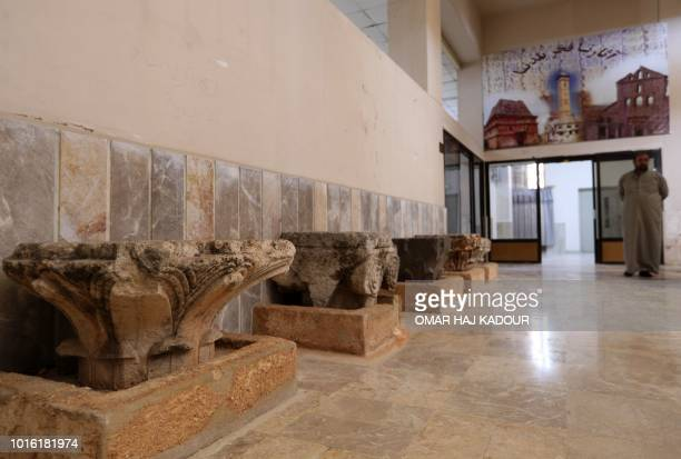 A man strolls at the Idlib Museum after it reopened on August 13 2018 in the northern Syrian city of Idlib An antiquities museum in Syria's rebelheld...