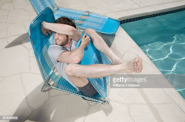 Man struggling with deck chair