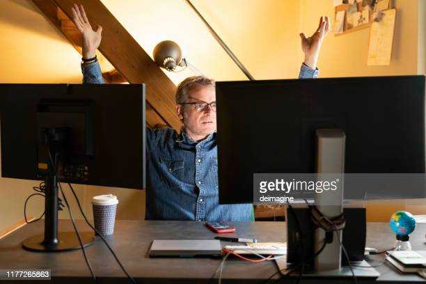 man struggling working with new technology - struggle stock pictures, royalty-free photos & images