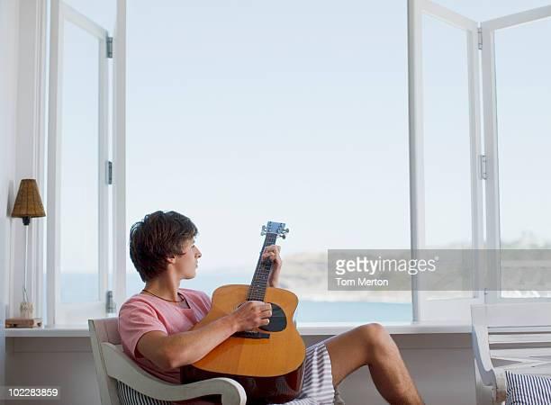 Man strumming guitar