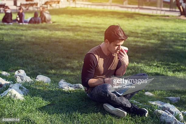 Man studying in the city park during the weekend