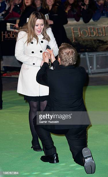 A man successfully proposes to his girlfriend at a royal film performance of 'The Hobbit An Unexpected Journey' at The Empire Leicester Square on...