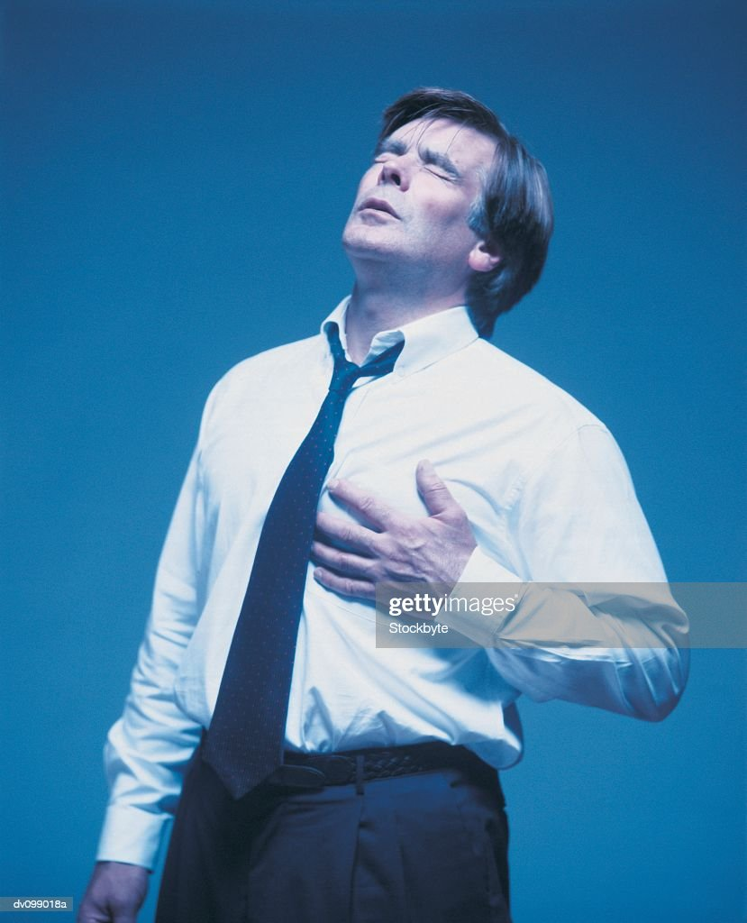 Man Suffering Chest Pain : Stock Photo